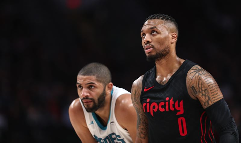 TRIBUNE PHOTO: DAVID BLAIR - Damian Lillard (right) and the Trail Blazers have done well this season against teams without a winning record, such as the Charlotte Hornets and former Blazer Nicolas Batum.