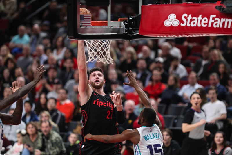 TRIBUNE PHOTO: DAVID BLAIR - Jusuf Nurkic splits the Charlotte defense to score for the Trail Blazers on Thursday night. He finished with 24 points and 14 rebounds.