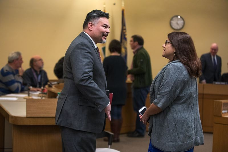 TRIBUNE PHOTO: JONATHAN HOUSE - Portland Public Schools Superintendent Guadalupe Guerrero and Portland Association of Teachers President Suzanne Cohen chat before Thursday evening's vote to approve a three-year contract.