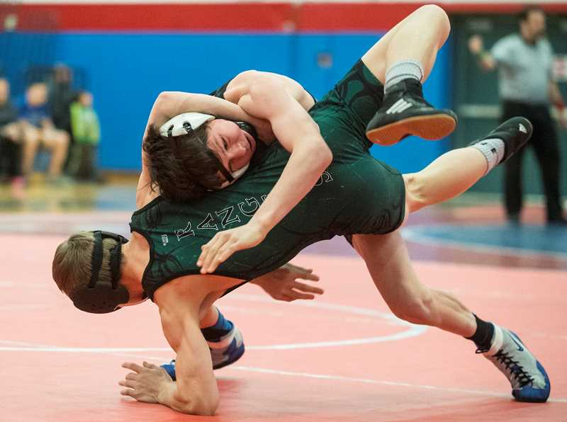 LON AUSTIN/CENTRAL OREGONIAN - Hunter Mode takes down Estacada's Landin Vittetoe at a dual meet held in Madras last week. Mode won by fall early in the first round of their 106-pound match.