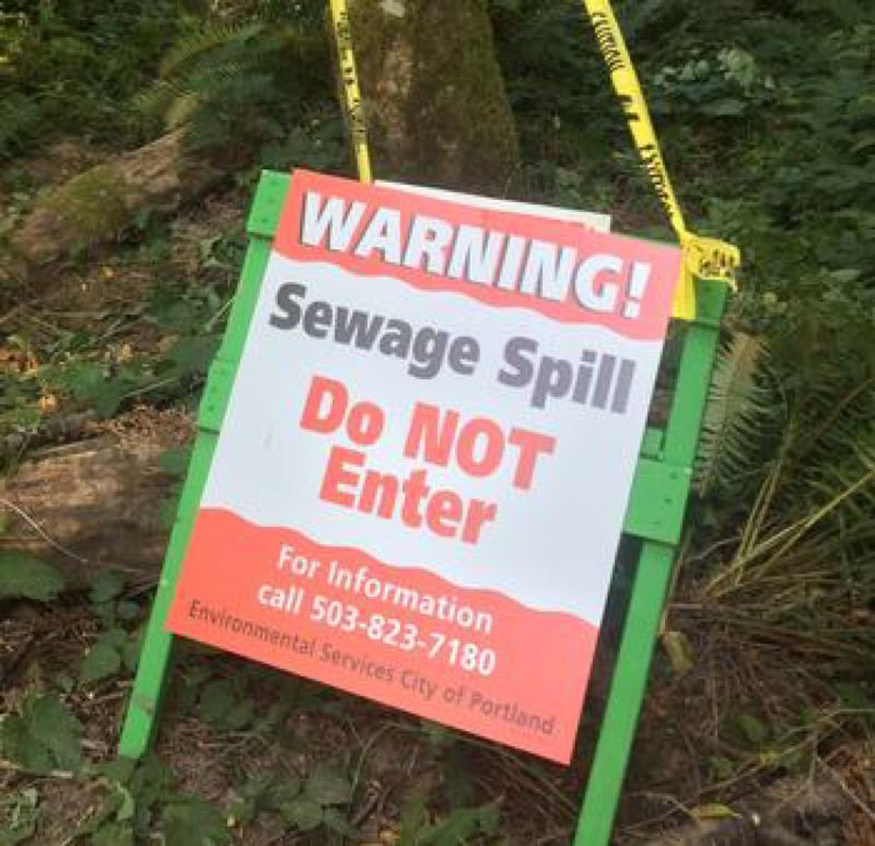 COURTESY PHOTO - A city of Portland sign warned in early July 2017 of a sewage spill near Woods Creek.