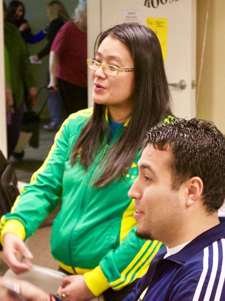OUTLOOK PHOTO: CHRISTOPHER KEIZUR - Pam Phan, with the Community Alliance of Tenants, helped organize and run Housing for the People Tuesday night, Feb. 6.