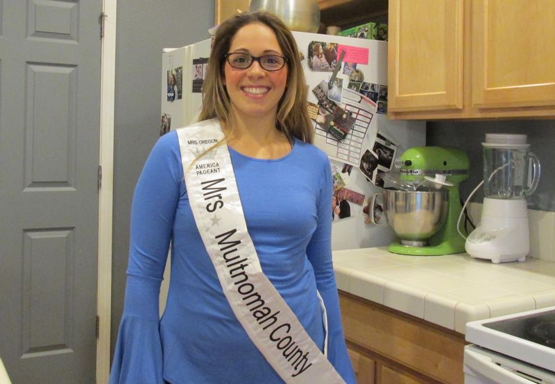 OUTLOOK PHOTO: TERESA CARSON - Mrs. Multnomah County dons her official sash and hangs out in the kitchen, always a center of busy family life.