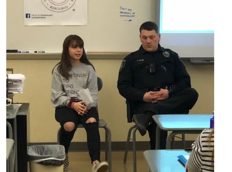 SUBMITTED PHOTOS - Eighth-grader Avi Palaoro, a board member of Continue to Find Kindness, introduces Oregon City High School resource officer Spencer Rohde at the Jan. 27 Family Focus Forum.