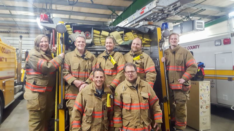FILE PHOTO - Some of Corbetts dedicated volunteer firefighters hang out at the station on Historic Columbia River Highway.