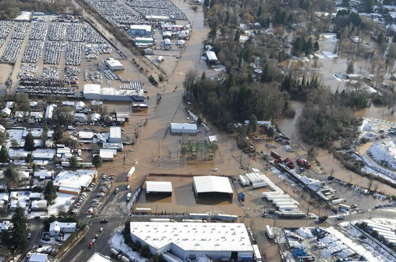 COURTESY PORTLAND BUREAU OF ENVIRONMENTAL SERVICES - A vast part of Lents was inundated when Johnson Creek overflowed its banks in 2009. The main street shown under water is Foster Road.