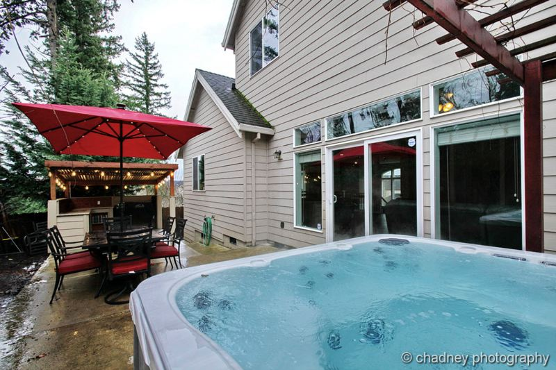 COURTESY CHADNEY PHOTOGRAPHY - A backyard paradise is decked out with a hot tub and covered BBQ dubbed The Cantina.