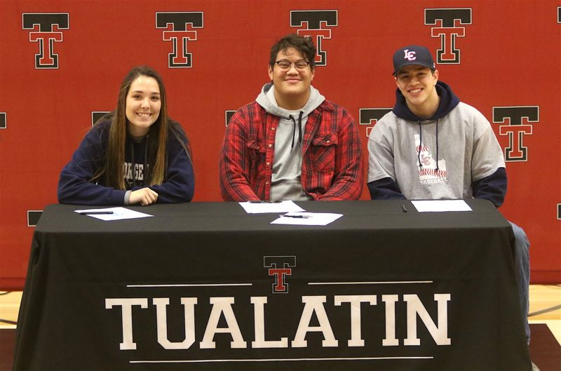 TIMES PHOTO: DAN BROOD - Tualatin High School students (from left) Brooke Jones, Gerald Saina and Cole Kinman signed their collegiate letters of intent.