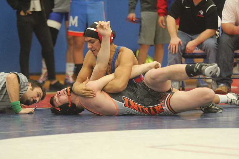 WILL DENNER/MADRAS PIONEER - Catalino LeClaire won both of his matches at Thursday's home duals.