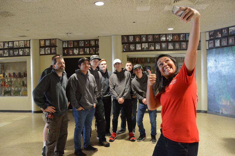 SPOTLIGHT PHOTO: NICOLE THILL - Kayleen McCabe posses for a selfie with students from the St. Helens High School Renovation and Remodeling class during a school visit on Friday, Feb. 9.