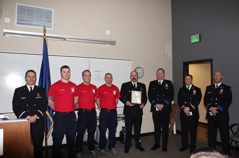 COURTESY PHOTO - Several Hillsboro firefighters were recognized for their work to help the community this week. The firefighters helped save the life of a 15-year-old Liberty High School student who collapsed late last year.