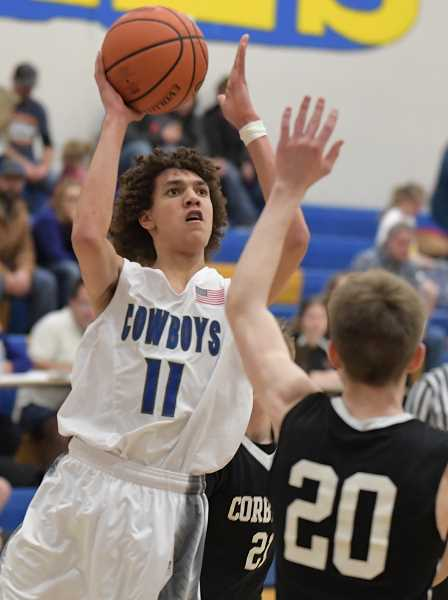 LON AUSTIN/CENTRAL OREGONIAN - Thaiden Mullan goes up for two of his game-high 21 points as the Crook County Cowboys defeated the Corbett Cardinals 58-43 Friday night in Prineville.