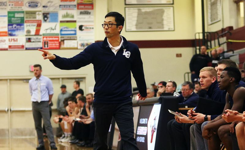 DAN BROOD - Lake Oswego coach Marshall Cho gives his team directions during Friday's game at Sherwood.