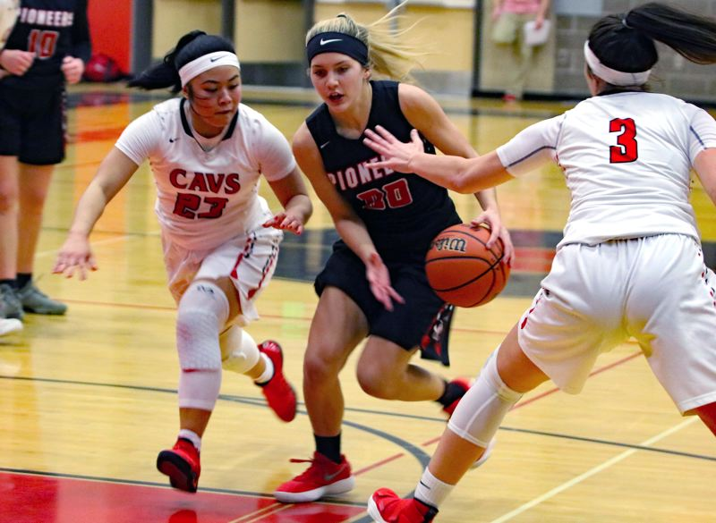 PAMPLIN MEDIA GROUP PHOTO: JIM BESEDA - Oregon City's Isabella Crowley splits two Clackamas defenders during her team's 44-42 upset win at Clackamas High School on Friday night.