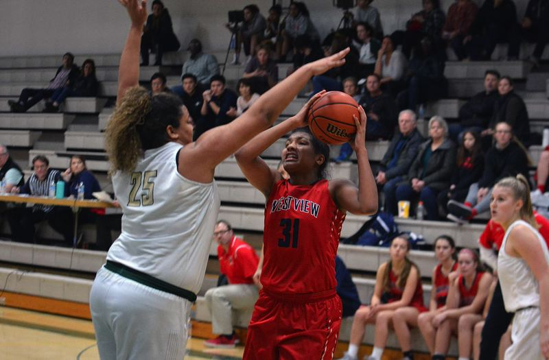 TIMES PHOTO: MATT SINGLEDECKER - Westview junior power forward Kamryn Jones tries to put up a jump hook over Jesuit post Jordyn Turner.