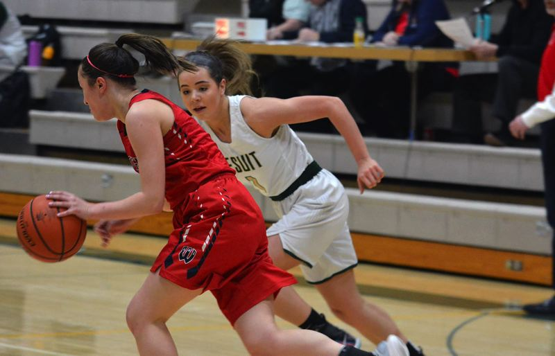TIMES PHOTO: MATT SINGLEDECKER - Jesuit shooting guard Taylor Freeman gives chase to a Westview point guard on Friday.