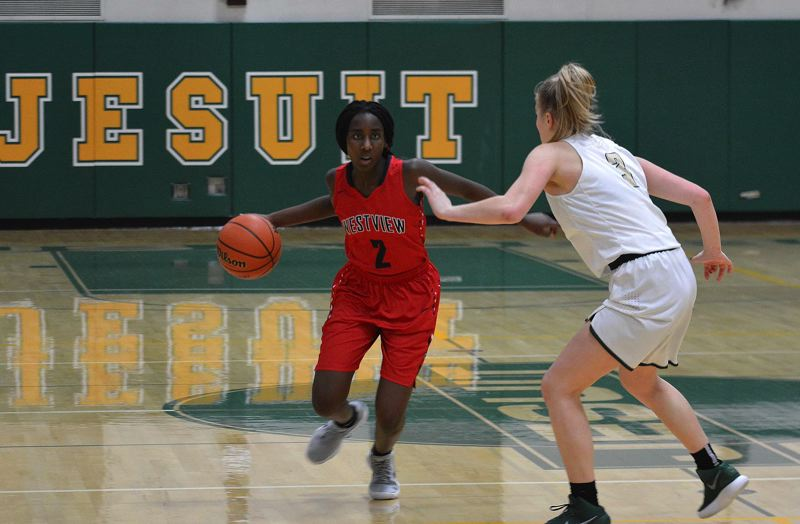 TIMES PHOTO: MATT SINGLEDECKER - Westview junior Shanice Uwase makes a move in the open floor against Jesuit.