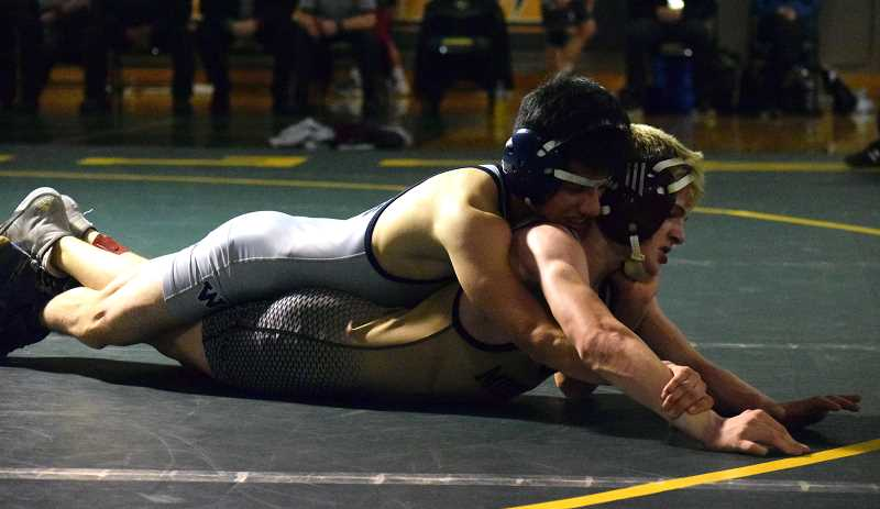 SPOKESMAN PHOTO: TANNER RUSS - Wilsonvilles Adzel Villanueva picked up a district title for the Wildcats on Saturda, Feb. 10 at Rex Putnam High School.