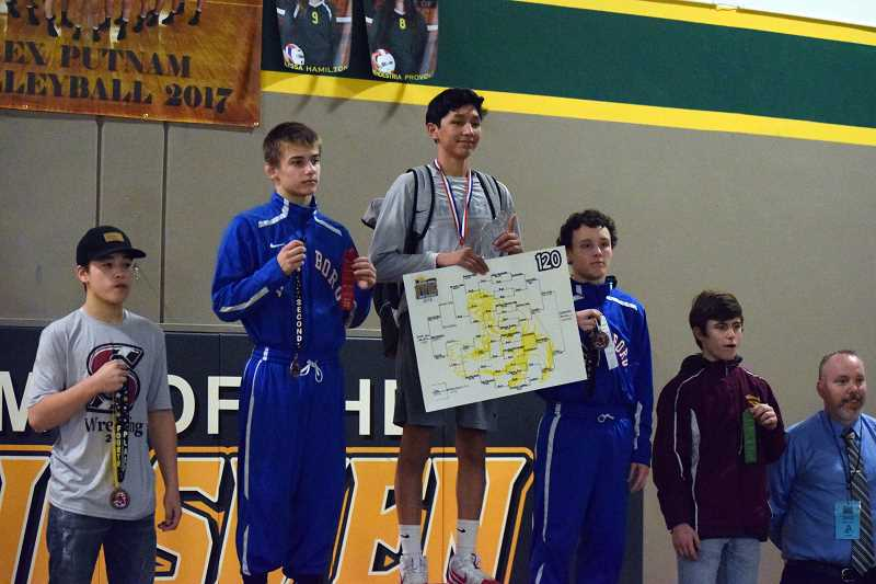 SPOKESMAN PHOTO: TANNER RUSS - Isaac Quesada won a decision at 120-pounds to claim the district title for Wilsonville.