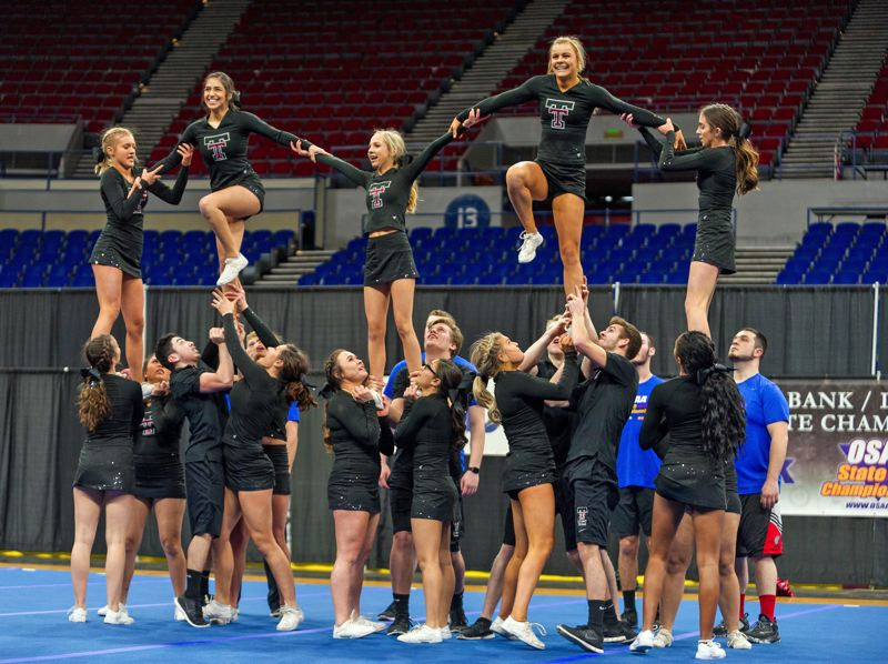 PAMPLIN MEDIA GROUP?: DIEGO G. DIAZ - Tualatin High School grabbed the top honors Saturday in the state cheerleading competition for large co-ed programs.