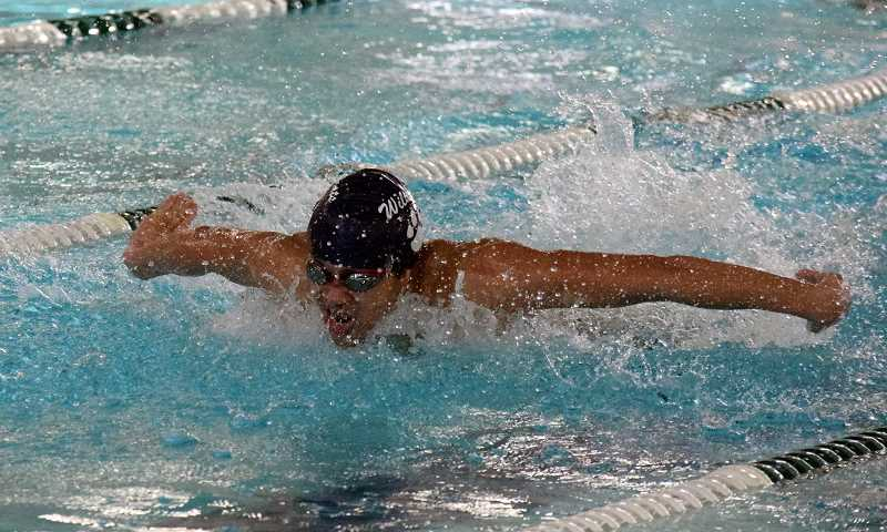 SPOKESMAN PHOTO: TANNER RUSS - Wilsonville's Wesley Norris won the 100-yard butterfly event in the NWOC meet on Feb. 10.