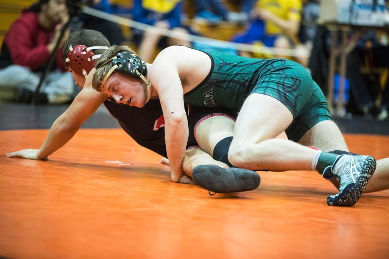 PAMPLIN MEDIA: LON AUSTIN - Estacada senior Justin Drury keeps a grasp on Tillamooks Austin Weeks on his way to a 4-1 decision in the 152-pound title bout.