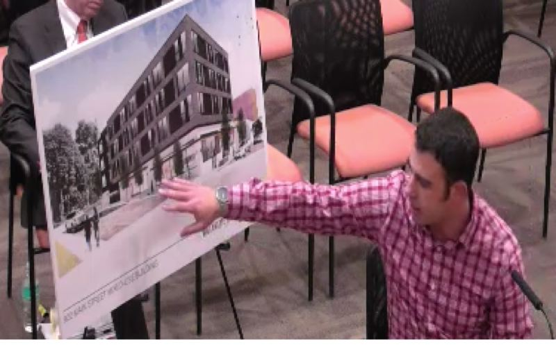 PHOTO COURTESY: WILLAMETTE FALLS MEDIA CENTER - Derek Metson, the architect for Willamette Stone LLC, shows plans for a new 10th/Main building to the Oregon City Urban Renewal Commission.