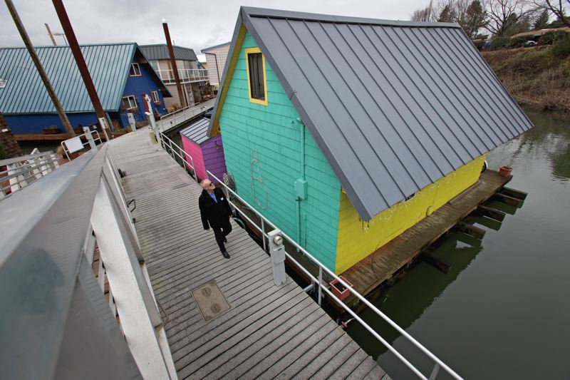 TRIBUNE PHOTO: JAIME VALDEZ  - Jantzen Beach floating home owner Ron Schmidt argues the city Bureau of Environmental Services is trying to 'tax the rain' by declaring houseboat rooftops are 'impervious surfaces.' Impervious surfaces usually refer to things like parking lots and sidewalks that don't allow rainfall to drain, causing it to flow onto city streets, sewers and rivers. The bureau sets utility fees for storm drainage based on the amount of impervious surface at apartments, condos and houseboat complexes.