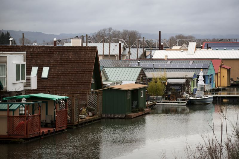 TRIBUNE PHOTO: JAIME VALDEZ - Portland houseboat owners are appealing a city determination that their rooftops are impervious surfaces. The owners argue that rainfall merely falls from their roofs into the adjoining river, and doesn't enter the city's extensive system for handling storm water drainage.