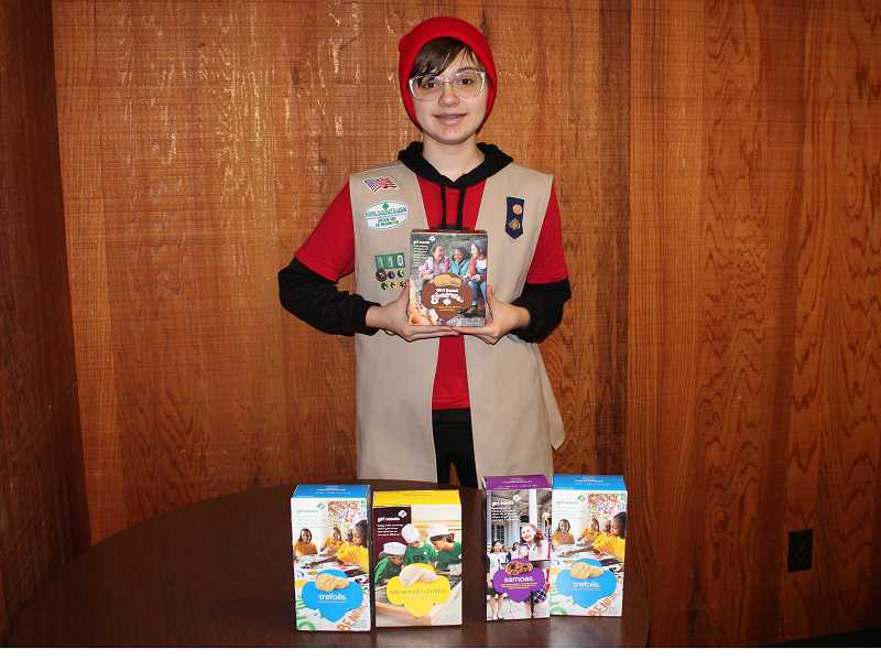 HOLLY SCHOLZ/CENTRAL OREGONIAN  - Girl Scout Troop 50110 Cadet Johanna Koivisto displays some of the cookie varieties available this season. Her troop is hosting a Girl Scout Cookie Tasting Night to kick off the 2018 cookie season on Friday evening at the Crook County Library.