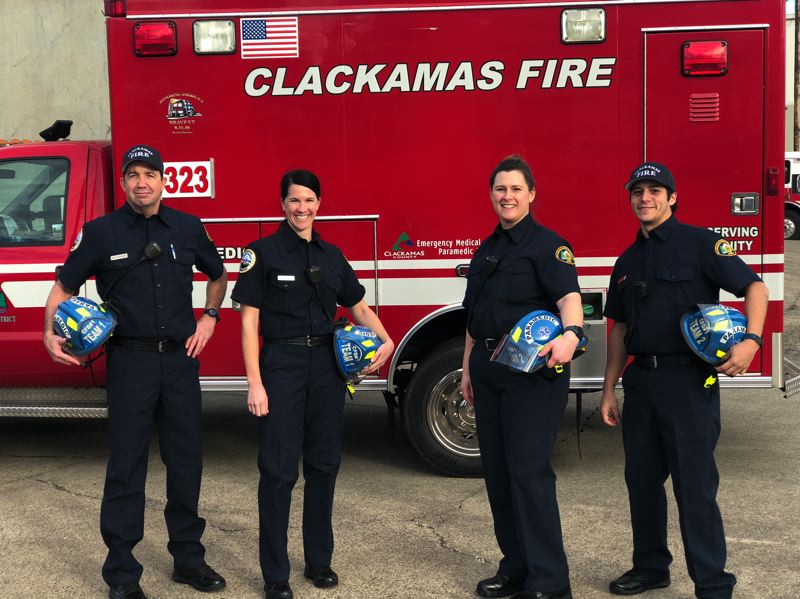 PHOTO COURTESY: CLACKAMAS FIRE - Clackamas Fire's new paramedics (from left), Dan Dyquisto, Kristin Lind, Ashley Hagey and Harold Chaves, stand in front of one of their ambulance-type vehicles.