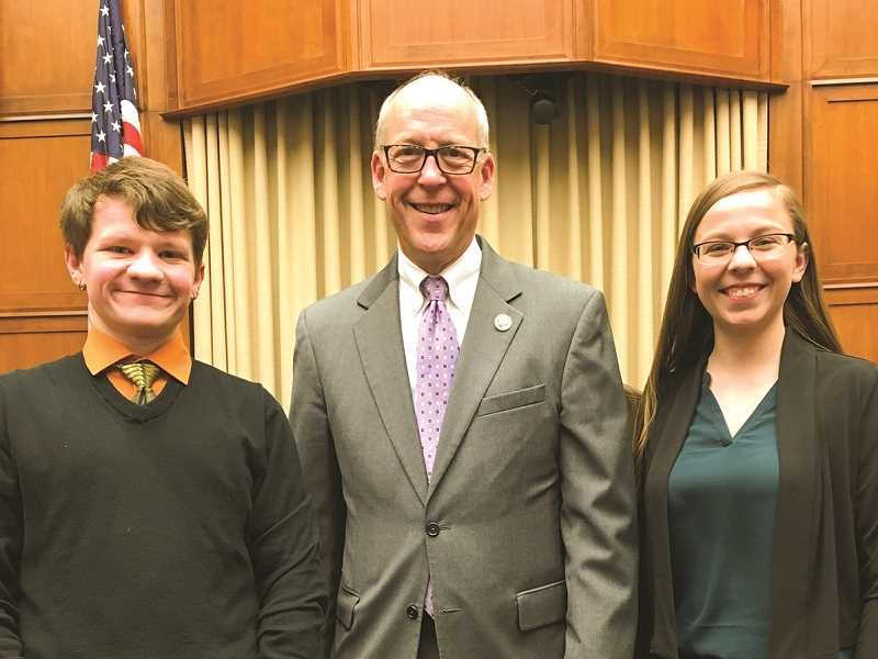PHOTO SUBMITTED BY HEATHER STUART - U.S. Rep. Greg Walden poses for a photo with Crook County High School juniors Mitchel Bennett, left, and Olivia Cooper.