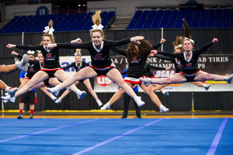 DIEGO G. DIAZ/FOR PAMPLIN MEDIA GROUP - Clackamas High School takes fifth place in the state cheerleading championships.
