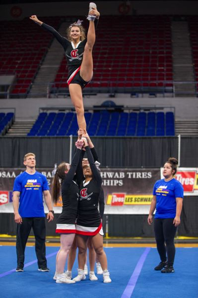 DIEGO G. DIAZ/FOR PAMPLIN MEDIA GROUP - Clackamas High School cheerleaders took home the 6A fifth-place honors Saturday, Feb. 10, during the OSAA State Cheerleading Championships in Portland.