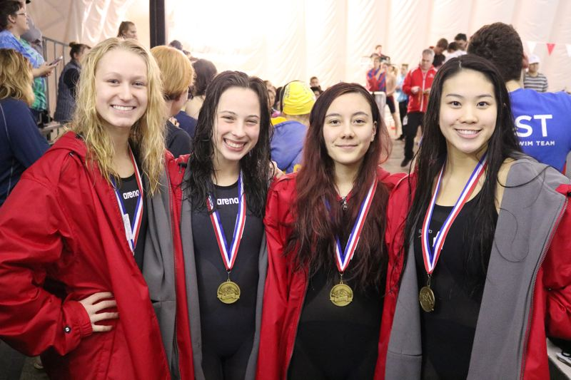 REVIEW/NEWS PHOTO: JIM BESEDA - Oregon City's 200 medley relay team of (left to right) Jane Shroufe, Olivia Watt, Samantha Brich and Jackalyn James set the pace in the opening event at Saturday's Mt. Hood Conference finals.