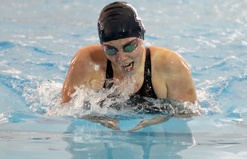 REVIEW PHOTO: MILES VANCE - Lake Oswego junior Grace Marshall speeds to second place in the 100-yard breaststroke at Saturday's Three Rivers League district swim meet at Mt. Hood Community College Aquatic Center.