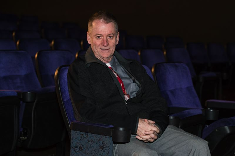 STAFF PHOTO: CHRISTOPHER OERTELL - Robert Perkins has owned and operated the Forest Theater in downtown Forest Grove since 2006, despite losing money on it each year. He loves the 1940s-vintage theater and hopes a new partnership with Ridgewalker Brewing can bring it some much-needed attention.