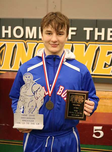 PAMPLIN MEDIA PHOTO: JIM BESEDA - Hilhi's Nick Peterson shows-off his trophies for winning the NWOC 138-pound title, and Wrestler of the Year in the 106-145 pound division at the NWOC District Championships Feb. 10.