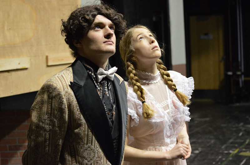SPOKESMAN PHOTO: CLARA HOWELL  - Senior Chance Hansen, left, and sophomore Averyl Hartje practice their roles as Algernon Moncrieff and Cecily Cardew during rehearsal.