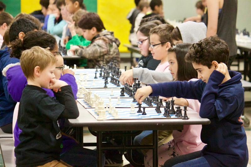 OUTLOOK PHOTO: CHRISTOPHER KEIZUR - Sportsmanship was an important aspect of the Chess for Success tournament Saturday afternoon, Feb. 10, at Wood Elementary School.