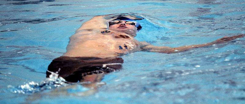 REVIEW PHOTO: MILES VANCE - Lakeridge senior Matt McComish gets ready to surface during his win in the 100-yard backstroke at the Three Rivers League district swim meet at Mt. Hood Community College Aquatic Center on Saturday.