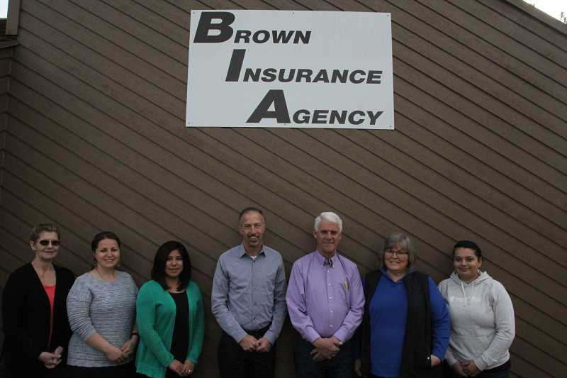 LINDSAY KEEFER - Brown Insurance Agency, 55 years in business, has five licensed agents and three support staff: (from left) Becky Halter (24 years with the agency), Elena Masaligin (two years), Melinda Orozco (eight years), Joe Egli (two years), Carl Brown (43 years), Laura Brown (35 years), Rachel Contreras (13 years) and (not pictured) Katia Cortes (one year).