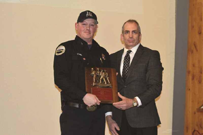COURTESY PHOTO: WFD - Jeremy Peil was presented wit the Career Firefighter of the Year Award by Chief Joe Budge.