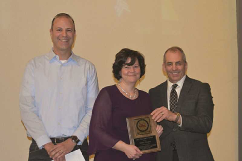 COURTESY PHOTO: WFD - Dawn Nelson (center), was given the Chief's Award by Chief Joe Budge and Joe Jacobucci.