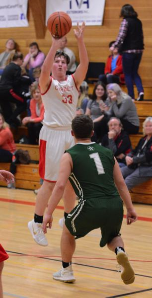 OUTLOOK PHOTO: DAVID BALL - Corbett's Cole Parsley fires up a 3-pointer in the first quarter of the Cardinals' home win over Estacada.