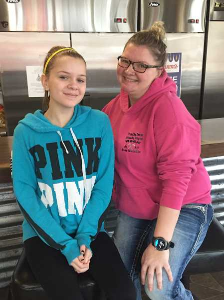 ESTACADA NEWS PHOTO: EMILY LINDSTRAND - Brandi Hoke, owner of the Trails Inn Cafe and Timber Room, and her daughter Keilani are excited for the upcoming prom event at the establishment. The event is for those ages 21 and older.