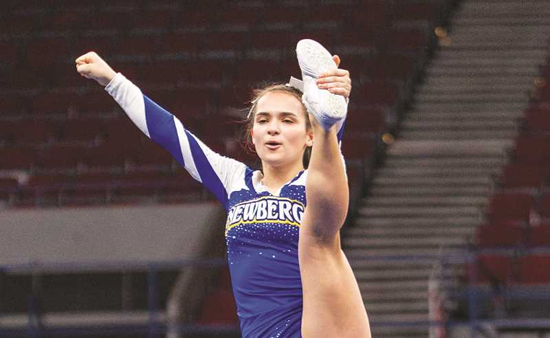 PMG PHOTO - The Newberg cheerleading team won its sixth consecutive OSAA state championship Saturday after wining the co-ed small division at Memorial Coliseum in Portland.