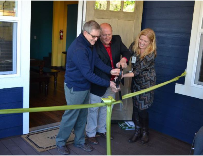 COURTESY CWS - The ribbon is cut to reopen The Village by (from left) Joe Robertson, board member of the Home Builders Foundation; Jim Bernard, Clackamas County Board chair; and Melissa Erlbaum, executive director of Clackamas Women's Services.