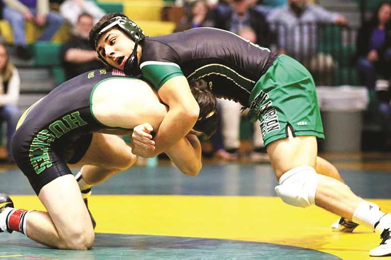 JO WHEAT - After winning his first district title in the 195-pound bracket on Saturday, North Marion senior Ramon Organiz is making his second trip to state, where he's looking to improve upon last year's sixth-place finish.