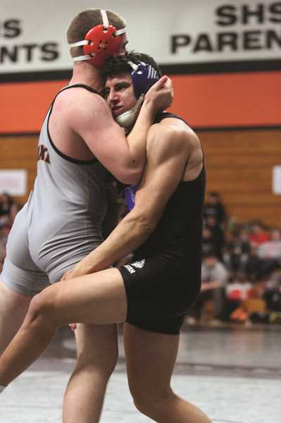 PHIL HAWKINS - Woodburn senior Chris Serrano will make his debut at the State Wrestling Championships after placing third in the 170-pound bracket at last week's district tournament.